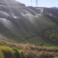 Sprinkler irrigation in steep field