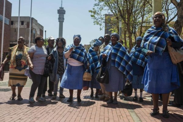 Residents of the Lesetlheng village community from the North West celebrating outside the Constitutional Court