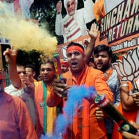 BJP supporters celebrate landslide victory. Photo- Reuters