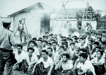Communists in Indonesia arrested by military junta, 1965.