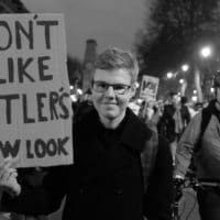 Protester's sign I don't like Hitler's new look