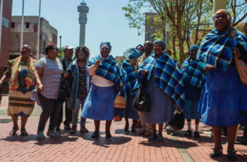 Residents from Lesetlheng village in South Africa's North West Province celebrating outside the Constitutional Court after it set aside the High Court interdict evicting them from their farm land. Ihsaan Haffejee, 2018.