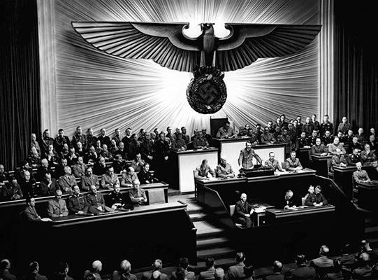 Adolf Hitler declares war on the United States in front of the German parliament, December 11, 1941. © Bundesarchiv