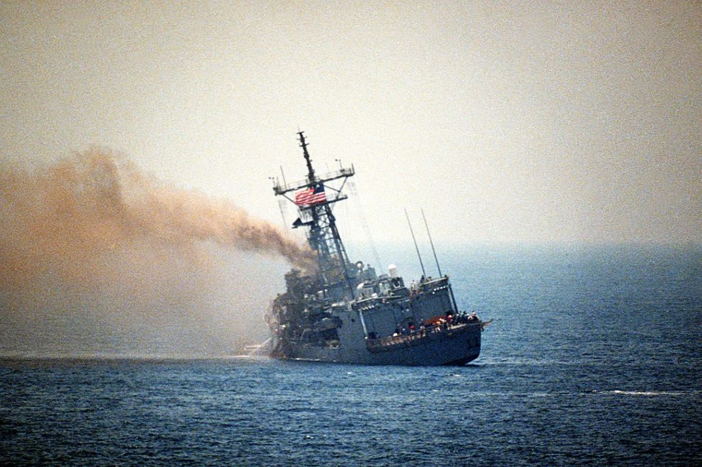USS STARK (FFG-31) listing to port after being hit by two Iraqi Exocet missiles