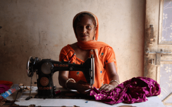 Woman engaged in home-based tailoring work in Bhirdana village, Haryana. July 2018. Photo credits: Celina della Croce