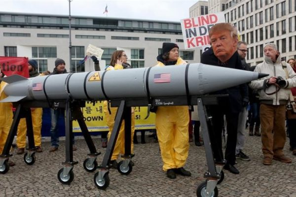 Activist with a mask of Donald Trump in a demonstration against nuclear weapons