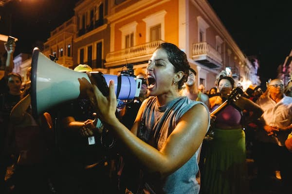 Protesters in Puerto Rico yell Ricky resign and take the Board (FCB) with you. We demand the resignation of Ricky, the legislature and the Fiscal Control Board. Photo- Four Two Photography, David Diaz