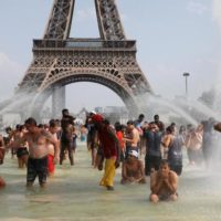 Record-breaking heatwave bakes Europe | Reuters.com Reuters People cool off in the Trocadero fountains across from the Eiffel Tower in Paris as a