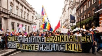 'Still Fighting Colonialism–Your Climate Profits Kill'
