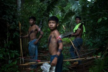 Members of the Uru-Eu-Wau-Wau, including Arima and his son Awapu, patrol for illegal land-clearing. The protected Uru-Eu-Wau-Wau forests contain important river basins that feed the rest of the region, including land used by cattle ranchers and soy farmers.Photos: Gabriel Uchida