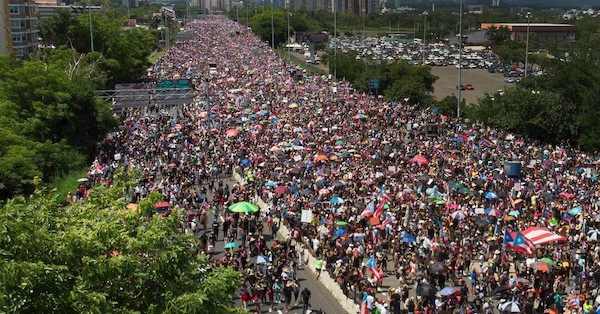 An aerial view shows thousands of people as they fill the Expreso Las Américas highway calling for the ouster of Gov. Ricardo A. Rosselló on July 22, 2019 in San Juan, Puerto Rico. (Photo: Joe Raedle/Getty Images)