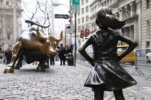 The Fearless Girl statue looks up the iconic Wall Street Charging Bull sculpture in New York on March 29, 2018. (Volkan Furuncu/Anadolu Agency/Getty Images)
