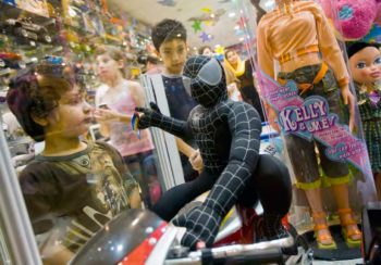 "Young Iranian boys look at a toy that depicts the character ""Spiderman"" at a shopping centre on the island of Kish in the Persian Gulf. Kish became the country's first free trade zone and the new gateway to Iran in 1982, being 17 km off the southern shore of mainland Iran. Kish, August 2008. Morteza Nikoubazl/Reuters"