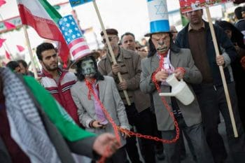 | Iranian protestors wear masks as well as hats with the US flag and Israeli flags | MR Online
