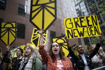 Activists rally in support of proposed Green New Deal legislation outside of Senate Minority Leader Chuck Schumer's New York City office on April 30, 2019. Photo- Drew Angerer:Getty Images