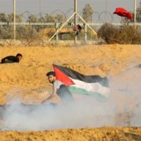 Israeli forces fire tear gas at Palestinian demonstrators during weekly protests