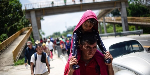 Central American migrants, part of a caravan to the U.S., walk beside the road between Metapa and Tapachula in Mexico on April 12, 2019. Photo: Pep Companys/AFP/Getty Images