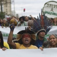 Indigenous people protest in defense of the Amazon while wildfires burn in that region, in Rio de Janeiro, Brazil, Sunday, Aug, 25, 2019. Experts from the country's satellite monitoring agency say most of the fires are set by farmers or ranchers clearing existing farmland, but the same monitoring agency has reported a sharp increase in deforestation this year as well. (AP Photo/Bruna Prado)
