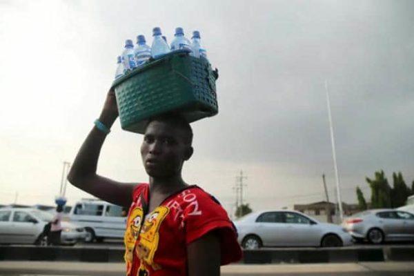 A man sells bottled water in Lagos, Nigeria PHOTO- Reuters:Akintunde Akinleye