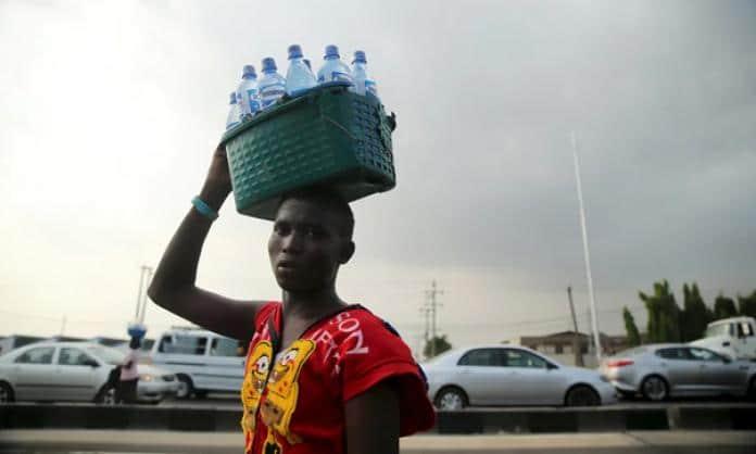   A man sells bottled water in Lagos Nigeria PHOTO ReutersAkintunde Akinleye   MR Online