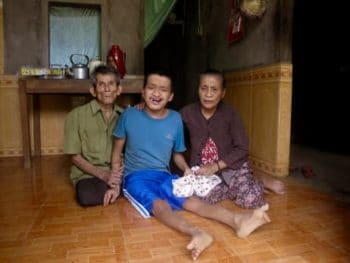 Le Thi Mit with her husband Nguyen Van Loc and their son Nguyen Van Truong in their home in Cam Nghia, Quang Tri Province. Photo by Sonya Schoenberger.