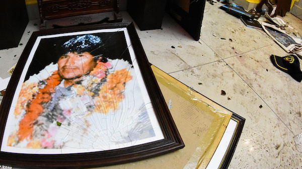 A broken portrait of former Bolivia's President Evo Morales is on the floor of his private home in Cochabamba, Bolivia, after hooded opponents broke into the residence on, Nov. 10, 2019. Photo | AP