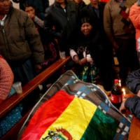Relatives mourn over the body of Antonio Quispe, killed by security forces, during a funeral at the San Francisco de Asis church in El Alto, outskirts of La Paz, Bolivia, Nov. 20, 2019. Natacha Pisarenko | AP