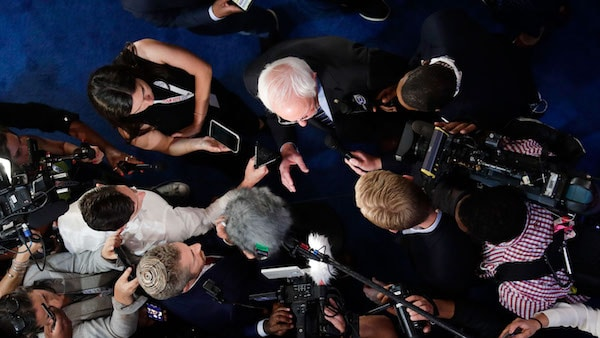 Sen. Bernie Sanders, I-Vt., center right, talks to the media in the spin room following the Democratic presidential primary debate hosted by ABC on the campus of Texas Southern University Thursday, Sept. 12, 2019, in Houston. (AP Photo/Eric Gay)