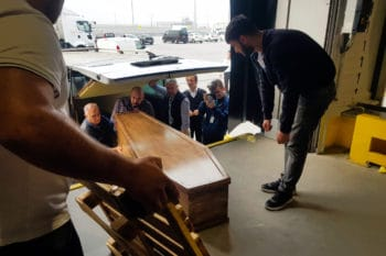 Airport workers upload the coffin of former British army officer James Le Mesurier onto a cargo plane prior to his repatriation at Istanbul Airport, Wednesday, Nov. 13, 2019. Turkey's state-run Anadolu news agency says the body of Le Mesurier who co-found the White Helmets volunteer group in Syria, has been transferred to Istanbul's main airport to be flown to London, following an autopsy. (IHA via AP)