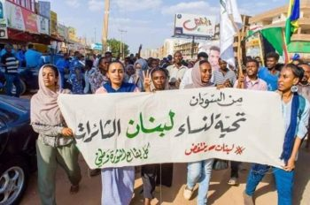 Sudanese women, including Alaa Saleh (age 22), take to the streets to say, 'From Sudan- A Salute to the Revolutionary Women of Lebanon'.