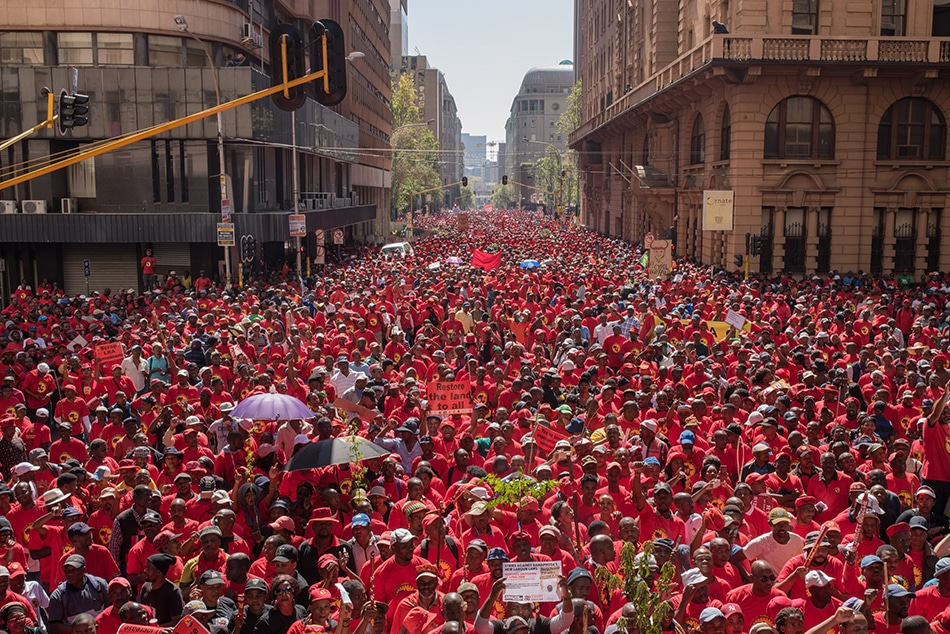 Thousands of SAFTU members stretch down Simmonds Street in central Johannesburg from outside the offices of the Gauteng Provincial government