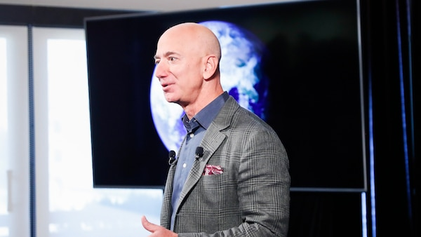 Amazon CEO Jeff Bezos answers questions during his news conference at the National Press Club in Washington, Thursday, Sept. 19, 2019. Bezos announced the Climate Pledge, setting a goal to meet the Paris Agreement 10 years early. (AP Photo/Pablo Martinez Monsivais)