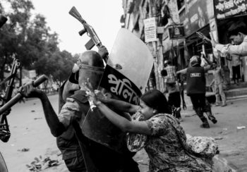 Andrew Biraj, Rahela Akhter, a Bangladeshi garment worker, resists the police, Dhaka, June 2010. Biraj is a student of Shahidul Alam, whose new book, The Tide Will Turn, is out from Steidl Books