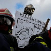Firefighters gather during a demonstration Tuesday, Jan. 28, 2020 in Paris. Participants want a raise in risk pay from 19% to 25% to fulfil their missions which they say reductions in personnel have made increasingly difficult. They say attacks against them are also on the rise.(AP Photo/Christophe Ena)