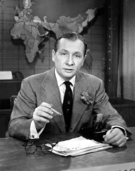 Journalist John Cameron Swayze on the set of the Camel News Caravan, a network news program aired by NBC from 1949 to 1956. Credit- NBC Television