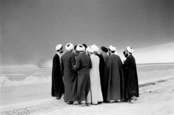 A group of mullahs are seen congregating near the front-line of the Iran-Iraq war, near the southern Iranian city of Abadan, in this handout file photograph received in London November 13, 2008. The picture, shot in 1983, is part of a London exhibition of photographs by Iranian photographer Kaveh Golestan, who died stepping on a landmine while covering the U.S. invasion of Iraq in 2003. REUTERS/Kaveh Golestan/Handout/ Files (IRAN). NO SALES. NO ARCHIVES. FOR EDITORIAL USE ONLY. NOT FOR SALE FOR MARKETING OR ADVERTISING CAMPAIGNS.