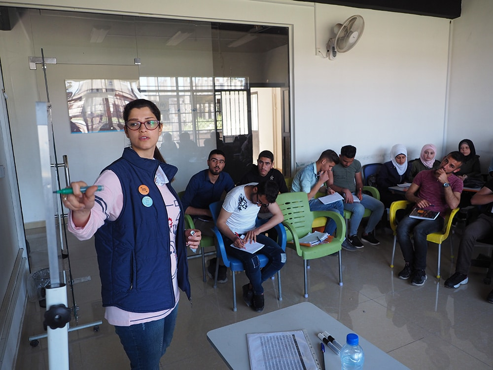 Walaa Kanawati from the Syria Trust for Development teaches English to young Aleppans at a former Islamic State prison in Hanano, eastern Aleppo.