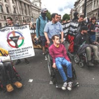 Disabled individuals protesting