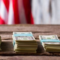 American flag, money and coins.