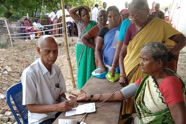 A volunteer taking a blood pressure test before a doctor's consultation at a CPI(M)-run camp in Wyra, Khammam District, Telangana. Tricontinental: Institute for Social Research