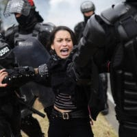 Police detain a protester in Bogota, Colombia, Tuesday, Jan. 21, 2020. Student and labor groups called for new protests as they hope to reignite demonstrations against President Ivan Duque that brought thousands to the streets late last year with a wide range of grievances with his conservative government. (AP Photo/Ivan Valencia)