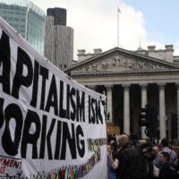 "This article is meant to clarify a point made earlier (Why Didn't Socialism Have Over-Production Crisis, Newsclick, June 30, 2018) about the erstwhile socialist economies not having over-production crises as capitalist economies do. It is in the nature of capitalism to have ""over-production crises"", i.e., crises arising from ""over-production"" relative to demand. ""Over-production"" does not mean that more and more goods keep getting produced relative to demand, so that unsold stocks keep piling up. This may happen only for a brief period in the beginning; but as stocks pile up, production gets curtailed, causing recession and greater unemployment. ""Over-production"", in short, is ex ante, in the sense that if production were to occur at full capacity use (or at some desired level of capacity utilisation), then the amount produced could not be sold because of a shortage of demand. But it manifests itself in reality in terms of recession and greater unemployment. It is a mistake to believe that such crises are only cyclical in nature, i.e., that they get automatically reversed after a certain period of time. On the contrary, the Great Depression of the 1930s, which was a classic over-production crisis, lasted nearly a decade and was finally overcome because of the war, or, to be precise, because of military expenditure in preparation for the Second World War. Read Also: Why Didn't Socialism Have Over-Production Crises? Since 2008, there has again been an over-production crisis that has persisted with varying intensity right until now. There is, thus, no question of an over-production crisis under capitalism automatically disappearing. But what was striking about the erstwhile socialist economies of the Soviet Union and Eastern Europe is that they were free from over-production crises. The question is why? Over-production crises under capitalism arise because of two main reasons. One, investment decisions under capitalism depend upon the expected growth of demand, for which the current growth of demand is taken as a clue: if demand slows down then investment gets restrained. Two, whenever investment gets restrained, so does consumption and hence total income (this is called the ""multiplier"" effect of investment). Both these factors were eliminated under socialism. Investment was undertaken according to a plan and not the dictates of profitability; hence, there was no question of investment being curtailed when the growth of demand slowed down for any reason. This is not to say that there were no fluctuations in the level of investment. These fluctuations, however, arose not in response to profit expectations, but for entirely exogenous reasons, of which, two in particular were important. One was agricultural output fluctuations. In years when the agricultural output went down for weather-related, or some other, reasons, investment was cut, in order to prevent excessive upward pressures on food prices; correspondingly when agricultural output revived, so did investment. These investment fluctuations, however, had nothing to do with any calculations of profitability on investment; they were unavoidable even in a planned economy. The second reason was the operation of ""echo effects"". Suppose, for instance, that a whole lot of new investment had been installed in a bunched manner at a certain date, say the beginning of the planning period. These pieces of equipment would become due for retirement again in a bunched manner around the same time some years later, which would, therefore, push up the investment plan, and hence the real gross investment around that time, so that both net investment and replacement needs are accommodated. The investment figure, therefore, would not show a steady growth but would exhibit fluctuations. But these fluctuations again had nothing to do with any calculations of profitability; they arose because of past investment history. But even when such investment fluctuations occurred, socialist economies ensured that they did not lead to fluctuations in consumption and income, i.e., those economies snapped the multiplier relationship that necessarily characterises capitalism. This is because all firms in the economy were asked to produce to their capacity, and, if demand was low because of investment being curtailed, then they were asked to lower their prices until whatever they produced got sold. At these ""market-clearing"" prices, some firms would make losses, while others would still make profits; but this would not matter since both the profit-making and the loss-making firms belonged to the State, which could, therefore, cross-subsidise the loss-making ones from the profits of the profit-making ones. And taking both groups of firms together, there would always be positive net profits as long as investment was positive (even if lower than would have been otherwise). This was a remarkable break from what happens under capitalism, and provides a clue to why output and employment fall in a crisis there. Under capitalism, a firm does not produce when prices do not cover costs; and when demand is low, prices do not fall, because they are ""administered"" through collusion among the oligopolistic firms. Instead, output, and hence employment, fall in order to equate supply with demand, and to eliminate stocks which might have got built up briefly. The matter can be looked at somewhat differently. A fall in price, with money wages and employment given, which is what happened under socialism, meant a rise in the share of wages in total output; income distribution in short shifted in favour of the workers. Since workers more or less consume their entire wages, such a shift in income distribution in favour of the workers raised the share of consumption in total output. Thus, socialist economies never experienced over-production crises because even when investment fell for some reason, output was kept unchanged and the share of consumption rose to compensate for the fall in investment (through a rise in the workers' share in output). This, however, can never happen under capitalism because capitalists would never voluntarily agree to a lowering of their share in output and a corresponding increase in workers' share, even in a situation of inadequate aggregate demand. This is why capitalism experiences over-production crises: income distribution here is a matter of intense class-struggle where there is no question of capitalists agreeing to lower their own share and correspondingly raise workers' share for the sake of overcoming a situation of over-production. The ""multiplier"" that operates under capitalism, whereby a reduction in investment causes a reduction in consumption and hence total output, occurs because of income distribution not being adjustable. The ""multiplier"", in other words, is predicated upon the relative shares among capitalists and workers being given. In fact, under capitalism, far from the workers' share rising to offset the problem of insufficient demand, the tendency in periods of crisis is the exact opposite, namely, to cut wages and raise the share of profits, which, in a situation of reduced investment that brought about the crisis in the first place, actually compounds the crisis. A 10% fall in investment in such a situation does not just bring about a 10% fall in output, as the ""multiplier"" analysis would suggest, but a more than 10% fall in output, say a 15% fall, because an additional squeeze on consumption through a fall in workers' share (via the wage cut) is further superimposed upon the reduction in investment. The fact that the relative share of the workers is not allowed to increase in order to offset the tendency towards over-production, which is a basic characteristic of capitalism, also shows its supreme irrationality as a system. It shows that the system would rather have larger unutilised capacity and unemployment, i.e., a sheer waste of productive resources for lack of demand, than produce as before by avoiding this waste through giving more to the workers. From its point of view, wasted resources are preferable to using these resources to improve workers' consumption. True, not being a planned system, it does not make such calculations consciously; but that is what its immanent tendencies amount to. Socialism avoids any waste or slack, such as is caused by a crisis, by raising the consumption of workers appropriately to avert it. As the collapse of the Soviet Union recedes further into history, people increasingly forget that a system had existed there, which, notwithstanding its many limitations and defects, had nonetheless been free of unemployment, of over-production crises and of the irrationality of capitalism."
