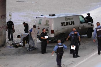 Mexican forensic experts examine the body of 14 year-old Sergio Hernandez, under the Paso Del Norte border bridge in Ciudad Juarez, Mexico. Photo | AP