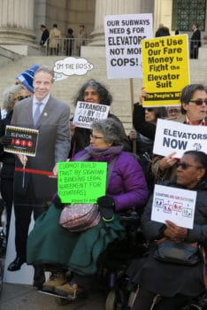 Activists with a cardboard cut-out of Governor Cuomo