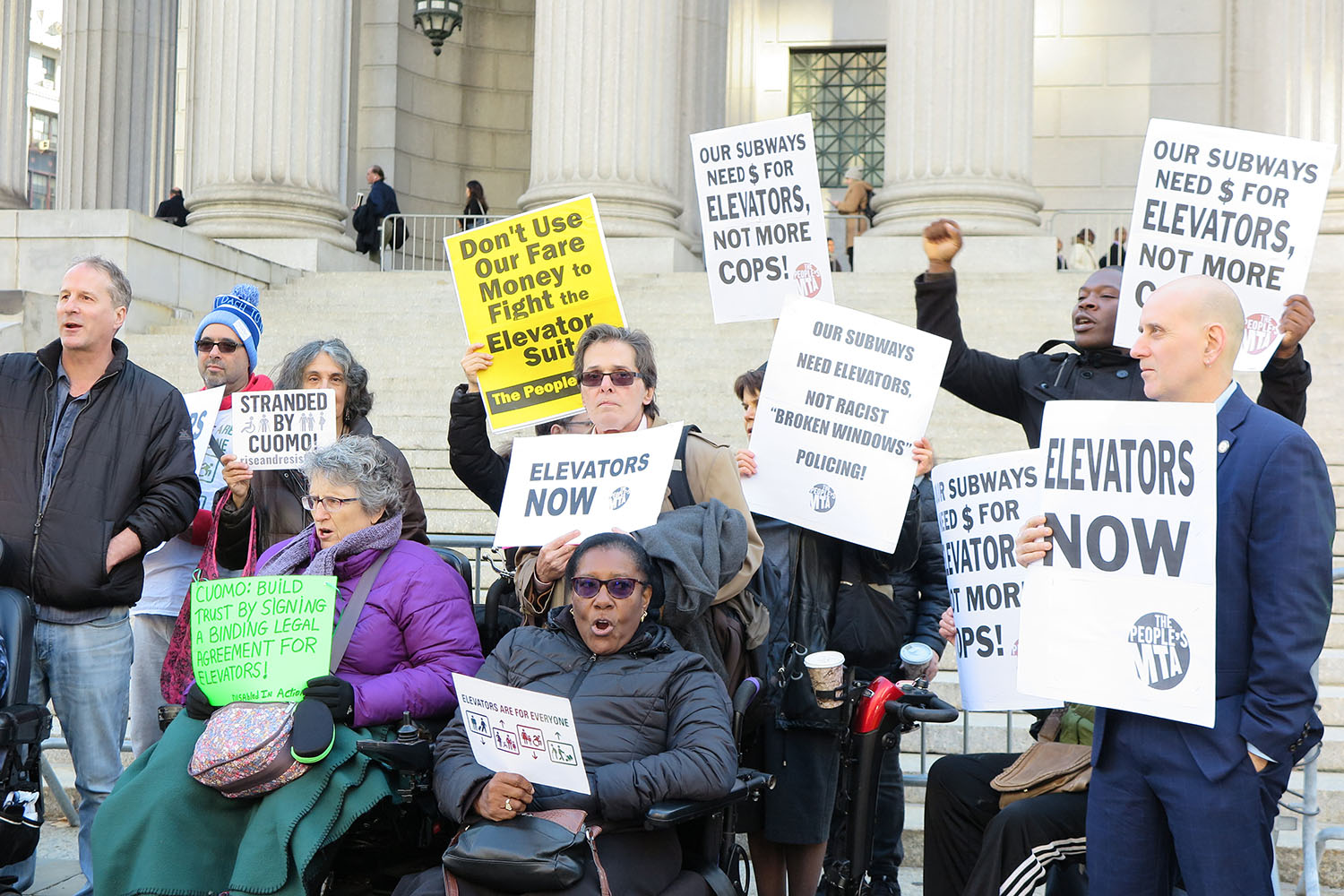 | Members of Peoples MTA Rise and Resists Elevator Action Group Disabled In Action and the Peoples Power Assemblies NYC protest at the base of the New York State Supreme Court Building | MR Online