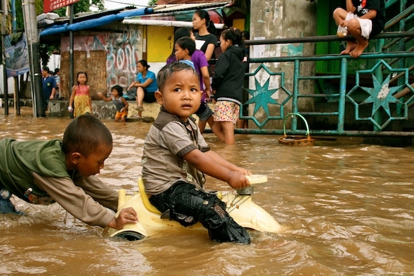 Children playing in flood water