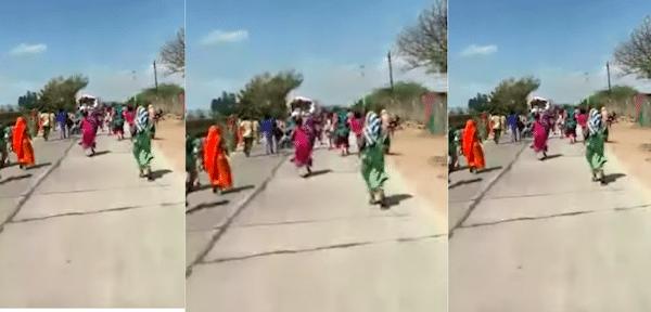 People run behind the flour truck in Rajasthan. Photo- Video screengrab
