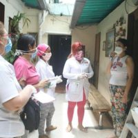 Venezuelan doctors conducting a COVID-19 house visit. Photo courtesy of @OrlenysOV