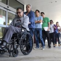 Californians wait in line to vote on Super Tuesday, March 3, 2020. AP Photo/Ringo H.W. Chiu
