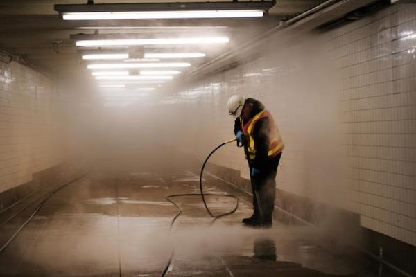 Workers clean a subway station in Brooklyn as New York City confronts the coronavirus outbreak on March 11, 2020 in New York City. , Spencer Platt/Getty Images